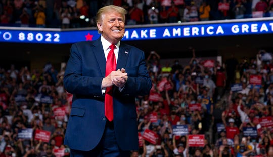 In this June 20, 2020, file photo President Donald Trump arrives on stage to speak at a campaign rally at the BOK Center in Tulsa, Okla. Trump's reelection effort allegedly hid nearly $170M in spending from mandatory public disclosure by routing payments through companies tied to former campaign manager Brad Parscale.