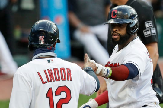 Cleveland Indians' Carlos Santana, right, celebrates with Francisco Lindor after Santana hit a two-run home run in the first inning in the second game of a doubleheader against the Chicago White Sox on Tuesday.