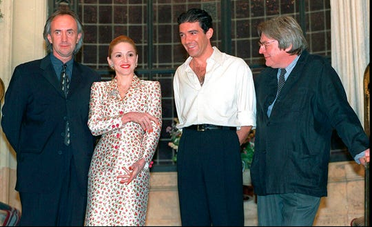 "British actor Jonathan Pryce, from left, American actress-singer Madonna and Spanish actor Antonio Banderas appear at news conference about the musical film ""Evita"" with British director Alan Parker in Buenos Aires on Feb. 6, 1996."