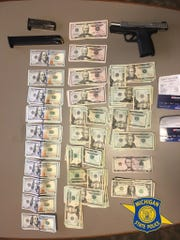 Michigan State Police found cash and a weapon during a search early Thursday.