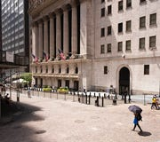 People pass the New York Stock Exchange, Thursday, July 30, 2020.