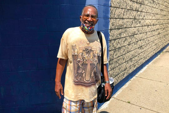 Victor Gibson poses for a photo July 9, 2020, in Detroit. Despite fears that the coronavirus pandemic will worsen, Gibson said he's not planning to take advantage of Michigan's expanded vote-by-mail system when he casts his ballot in November.