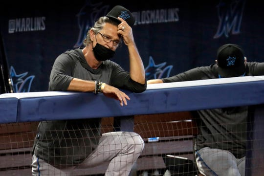 Miami Marlins manager Don Mattingly watches a baseball scrimmage at Marlins Park in Miami. The Marlins, one of the most under-the-radar teams in sports, have made news lately, all of it bad. Overtaken by a coronavirus outbreak, the team must scramble for roster replacements as they try salvage a season barely underway.