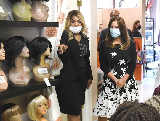 Second Lady Karen Pence (right) visits with Ferndale business owner Haith Johnson, of Le'Host Hair & Wigs, on Friday, July 31, 2019.  Johnson, provided an overview of their work with the Small Business Administration, especially as it relates to adapting to the COVID-19. Le'Host specializes in wigs for veterans and cancer patients. Mrs. Pence and toured with Acting Deputy Secretary of Veterans Affairs Pamela  Powers learned more about the owner's work with providing quality wigs to veteran and cancer patient customers.