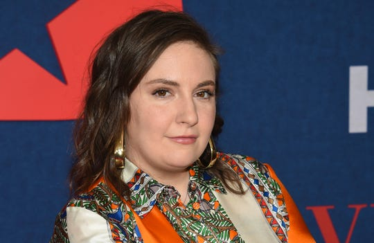 """Lena Dunham, the 34-year-old creator and star of HBO's """"Girls'"""" said in a long Instagram post on Friday that what began as moderate aches were followed by a high fever, """"crushing fatigue,"""" and the feeling that she was losing control of her body. She said the serious symptoms subsided after three weeks and she tested negative after a month."""