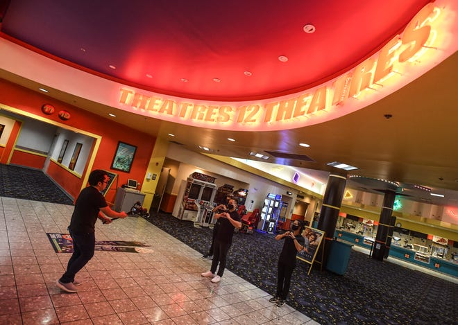 Still temporarily closed to the public, Tango Theaters employees at the Micronesia Mall, use the down time to produce an in-house video advertisement while recoding in the lobby of the megaplex on Friday, July 31, 2020.