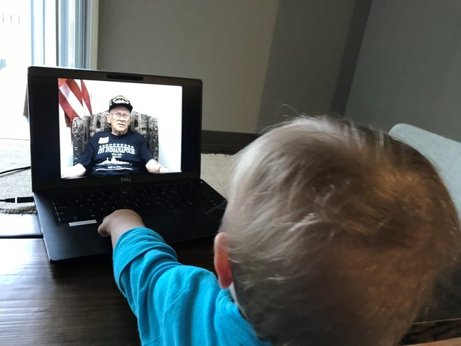Felix Briggs watches a video of his great-grandfather, George Laws, speaking in a Library of Congress video about his experience as a survivor of the USS Indianapolis sinking.