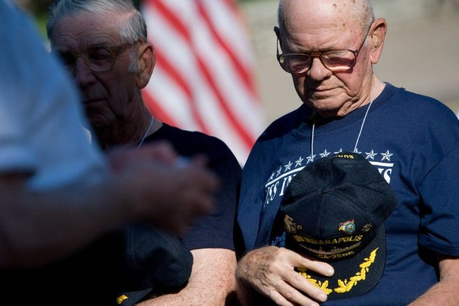 George Laws, right, stands near the USS Indianapolis Memorial in Downtown Indianapolis on Aug. 3, 2008.