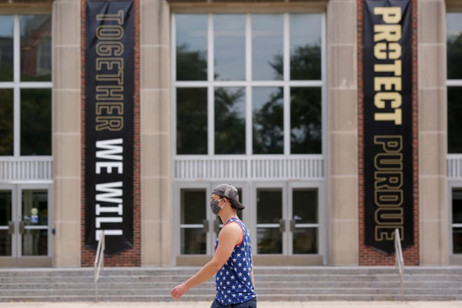 """""""Together We Will Protect Purdue"""" banners hang outside Purdue University's Stewart Hall, Friday, July 31, 2020 in West Lafayette."""