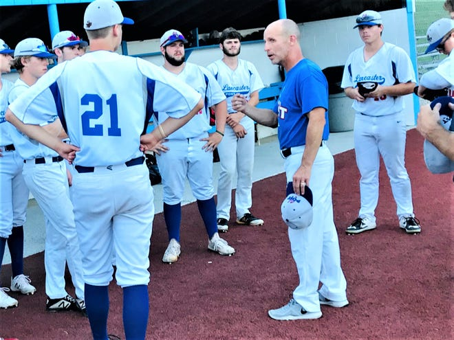 Lancaster Post 11 baseball coach Dana Rowland talks with his players after recent game at Beavers Field.