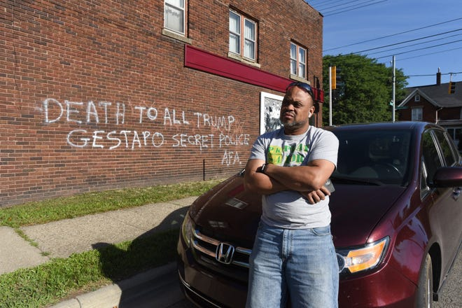Randy Brown of Lansing talks about the anti-Trump and anti-police messages graffitied on the building he owns, Friday, July 31, 2020.