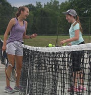 Kelsey Weingart, left, of Tiffin and Noel Cline of Bellville share a laugh while playing in the girls 14 finals of the 87th News Journal Tennis Tournament at Lakewood Racquet Club.