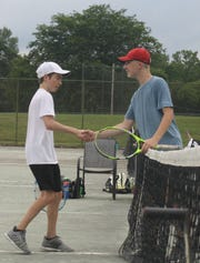 Karl Etzel, right, and Owan Gongwer shake hands after their championship match in the 87th News Journal/Richland Bank Tennis Tournament at Lakewood Racquet Club.