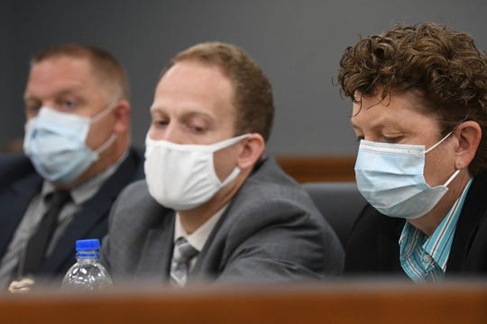 The prosecution table consisting of Mansfield police Sgt. Matt Loughman and Assistant Prosecutors Matt Metcalf and Teri Burnside, all wear masks during a recent court case in Richland County Pleas Court. Masks are still required in Richland County even though the health risk advisory was lowered to Level 1 or yellow.