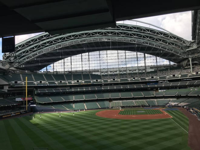 Brewers players are shown warming up on Friday, July 31, 2020 at Miller Park in Milwaukee, Wis.The Milwaukee Brewers' scheduled home opener Friday afternooon at Miller Park against St. Louis has been postponed because of positive coronavirus tests with the Cardinals travel party.