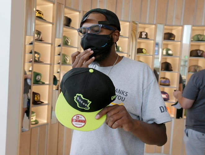 Penn Carlyle searches for the perfect hat at the Milwaukee Bucks Pro Shop reopened Friday,. The store is featuring summer jersey's and masks as well as hats and other Bucks gear.