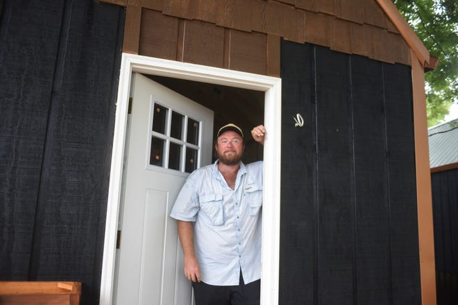 Mark Bertel stands in the doorway of one of the 10 tiny homes his construction company is currently building in Mountain Home.