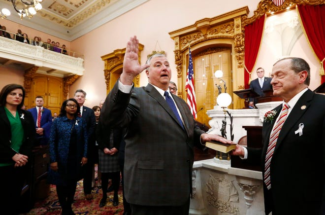 Rep. Larry Householder takes the oath of office after being elected as theOhio House speaker in 2019. He will still be on the fall ballot despite being indicted as part of a massive bribery and corruption scheme. Four write-in candidates are opposing him.