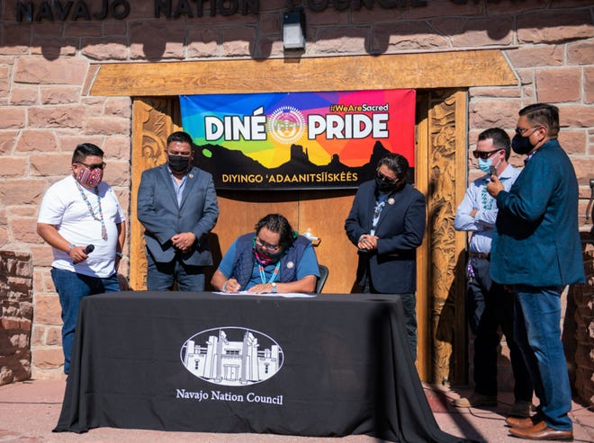 Speaker Seth Damon, center, signs on July 31 the Navajo Nation Council resolution to declare the third week in June of each year as Diné Pride Week on the Navajo Nation.