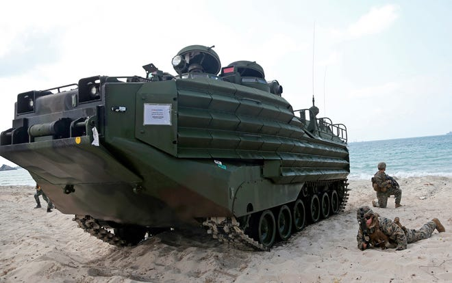 """FILE - U.S. marines land with an amphibious assault vehicle (AAV) during a U.S.-Thai joint military exercise titled """"Cobra Gold"""" on Hat Yao beach in Chonburi province, eastern Thailand, Saturday, Feb. 16, 2019. A training accident off the coast of Southern California in an AAV similar to this one has taken the life of one Marine, injured two others and left eight missing Thursday, July 30, 2020. In a Friday morning tweet, the Marines say the accident happened Thursday and search and rescue efforts are underway with support from the Navy and Coast Guard. (AP Photo/Sakchai Lalit)"""
