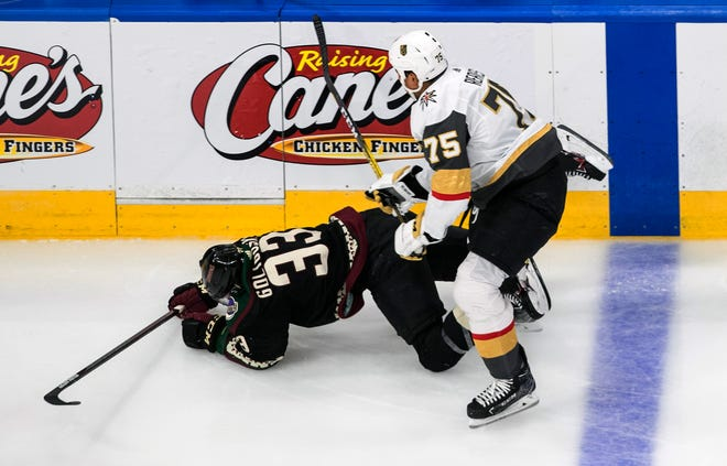 Arizona Coyotes' Alex Goligoski (33) is checked by Vegas Golden Knights' Ryan Reaves (75) during the second period of an exhibition NHL hockey game Thursday, July 30, 2020 in Edmonton, Alberta. (Jason Franson/The Canadian Press via AP)