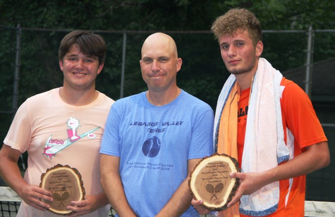 Runner-up Dylan Tull, left, and champion Ben Clary pose with tournament director Mike Rohrbach following the Mt. Gretna Men's Club singles final on Thursday night.