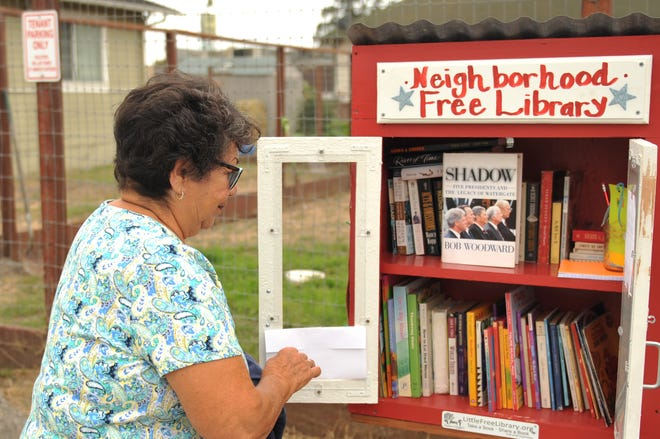 Cornie Gugale set up the Neighborhood Free Library to provide reading options for kids throughout the summer. July 30, 2020.