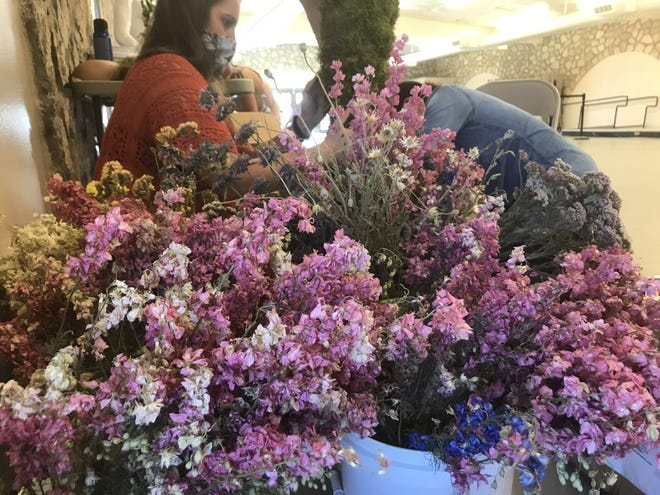 A group of florists from El Paso and New Mexico are working together to create 23 moss and flower covered silhouettes to honor the victims of the Aug. 3, 2019 Walmart mass shooting in El Paso. The silhouettes will be displayed at this weekend's opening of El Paso County Community Healing Garden.