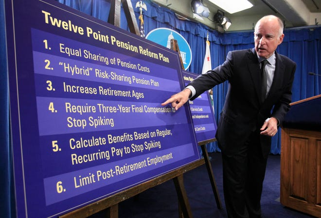 "In this Oct. 27, 2011, file photo, Gov. Jerry Brown gestures to a chart showing some of his proposals to rollback public employee pension benefits during a news conference at the Capitol in Sacramento, Calif. California's decades-old protections for public employees' retirement benefits are not enough to bar state lawmakers from enacting reforms designed to prevent abuses such as ""pension spiking,"" the state Supreme Court unanimously ruled Thursday, July 30, 2020."