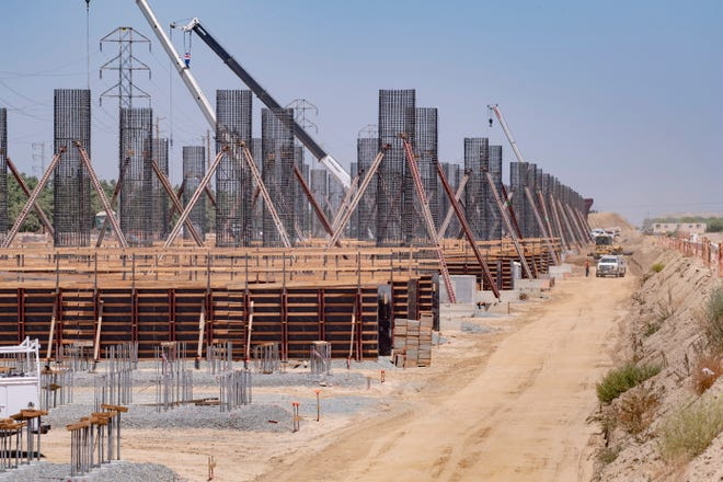 Construction crews build dozens of columns on Thursday, July 30, 2020 to support California high-speed rail tracks that will cross Highway 198 just east of Highway 43 in Central California.