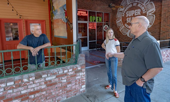 Steve Nelsen, right and Randi Irvin talk with Rocky Salinas at Rocky Salinas, owner of Alejandra's Mexican Restaurant, on Friday, July 31, 2020. Some parking spaces in Downtown Visalia  were converted to dining areas for the restaurants that requested it.