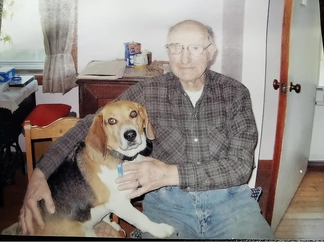 Carl A. Neff, of Streetsboro, died last November at age 97 and left $525,000 to three Portage County non-profit organizations. With him is his dog Spencer. (Submitted photo)