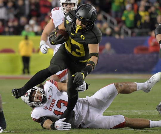 Oregon running back Cyrus Habibi-Likio carries the ball against Utah during the first half of the 2019 Pac-12 Conference championship game at Levi's Stadium.