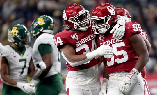 Oklahoma players celebrate during their 30-23 win over Baylor in the 2019 Big 12 Championship Game at AT&T Stadium.