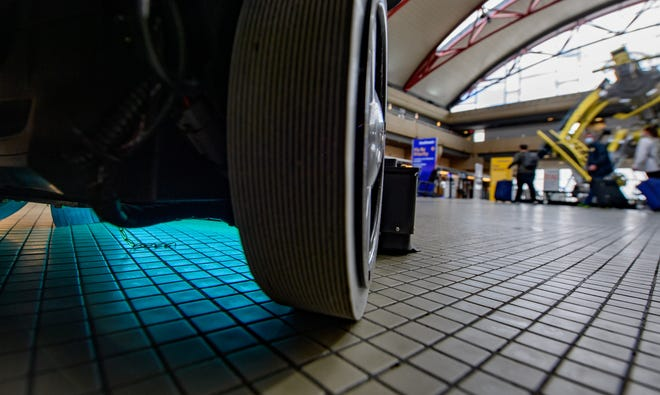 A UV cleaning robot cleans the floor near the ticketing windows at Pittsburgh International Airport on May 7, 2020 in Pittsburgh, Pennsylvania.