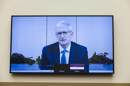 Apple CEO Tim Cook speaks via video conference during a House Judiciary subcommittee hearing on antitrust on Capitol Hill on Wednesday, July 29, 2020, in Washington. (Graeme Jennings/Pool via AP) ORG XMIT: WX503