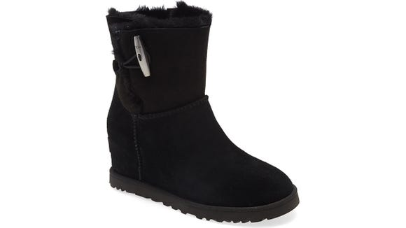 These UGG boots feature a wedge and a plush shearling interior.