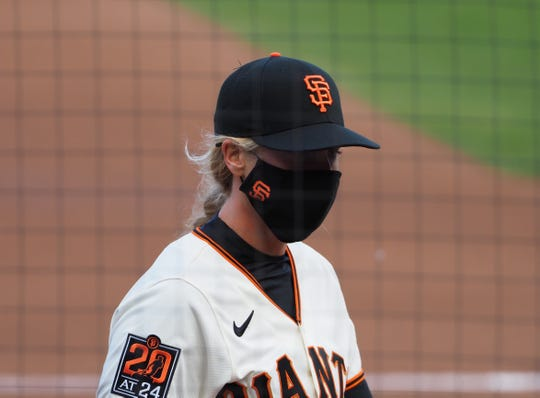 Nakken enters the dugout before a game against thPadres at Oracle Park