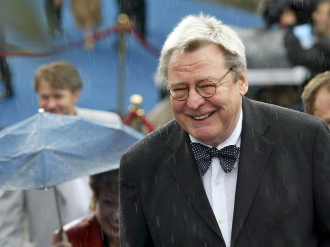 Film director Alan Parker arrives at the opening ceremony of 26th Moscow International Film Festival in Moscow on June 18, 2004.