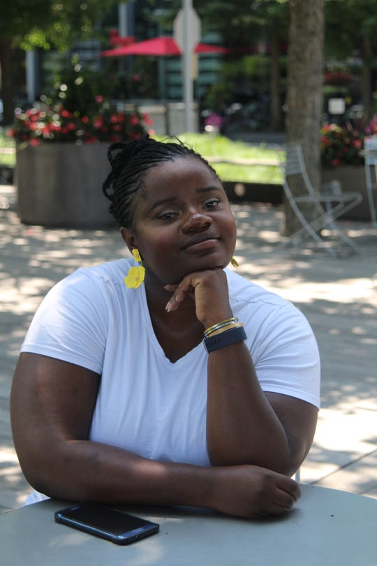 Sinmi Araoye, 33, sitting outside in Boston, Massachusetts, in September 2019.