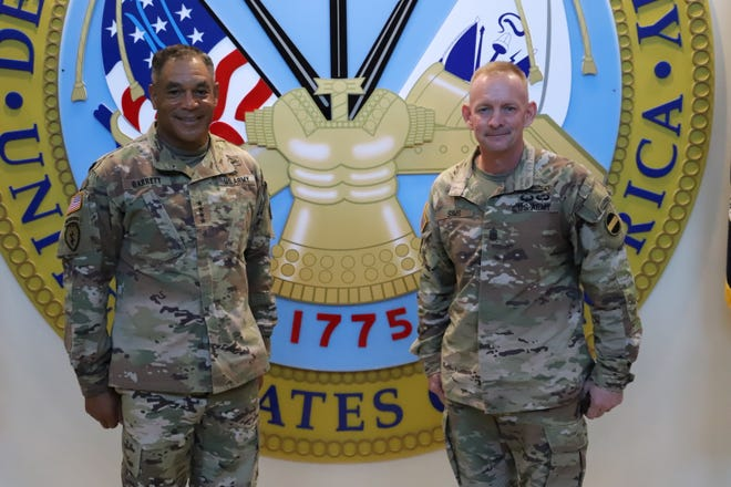 Gen. Michael Garrett, commander of the U.S. Army Forces Command, welcomes new Command Sgt. Maj. Todd Sims as the command's top enlisted adviser during an assumption of responsibility ceremony Monday at Fort Bragg.