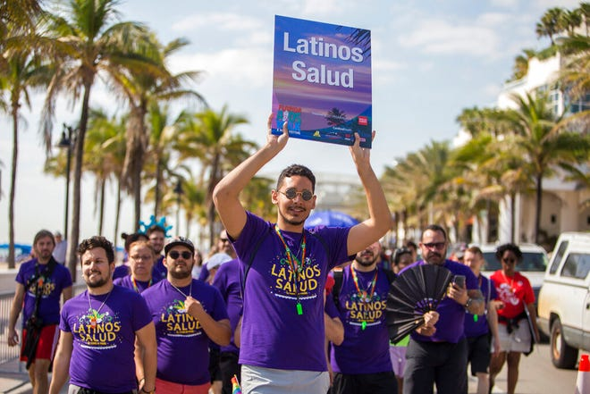 Members of the South Florida organization, Latinos Salud, come out to raise funds to fight HIV at the 2019 Florida AIDS Walk & Music Festival presented by AIDS Healthcare Foundation on Saturday, March 23, 2019 in Fort Lauderdale, Fla. (Jesus Aranguren/AP Images for AIDS Healthcare Foundation)
