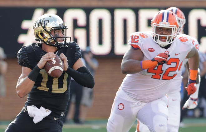 Quarterback Sam Hartman, left, and Wake Forest will have to contend with the likes of Clemson under the ACC's modified football schedule for the fall. [The Associated Press]