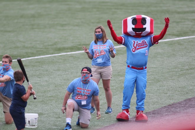 Florence's water tower mascot cheers on young fans in a water balloon contest as the Florence Y'alls defeated the Lexington Legends 14-3 in the season opener of the Battle of the Bourbon Trail July 31, 2020 at UC Health Stadium, Florence, Ky.