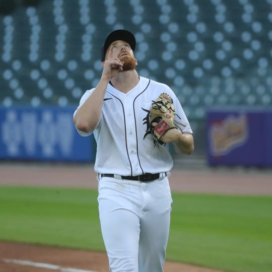 Tigers pitcher Spencer Turnbull walks off the field after pitching against the Reds during the third inning at Comerica Park on Friday, July 31, 2020.