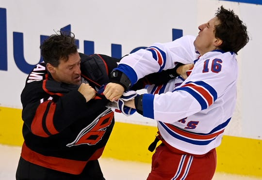 Former Plymouth Whaler Justin Williams, left, fights Rangers forward Ryan Strome during the first period of the Carolina-New York playoff series in Toronto on Saturday.