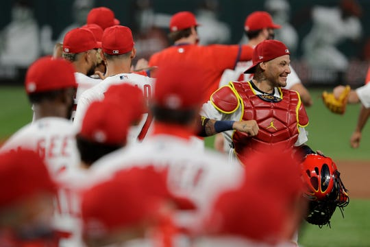 St. Louis Cardinals catcher Yadier Molina, right, celebrates a 5-4 victory over the Pittsburgh Pirates in a baseball game Friday, July 24, 2020, in St. Louis.