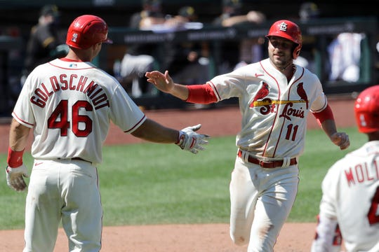 St. Louis Cardinals' Paul DeJong (11) celebrates with Paul Goldschmidt (46) after both players scored on a double by Matt Carpenter during the eighth inning against the Pittsburgh Pirates  July 25 in St. Louis.