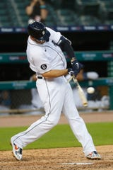 Detroit Tigers' C.J. Cron breaks his bat in the sixth inning of a baseball game against the Cincinnati Reds on Friday.