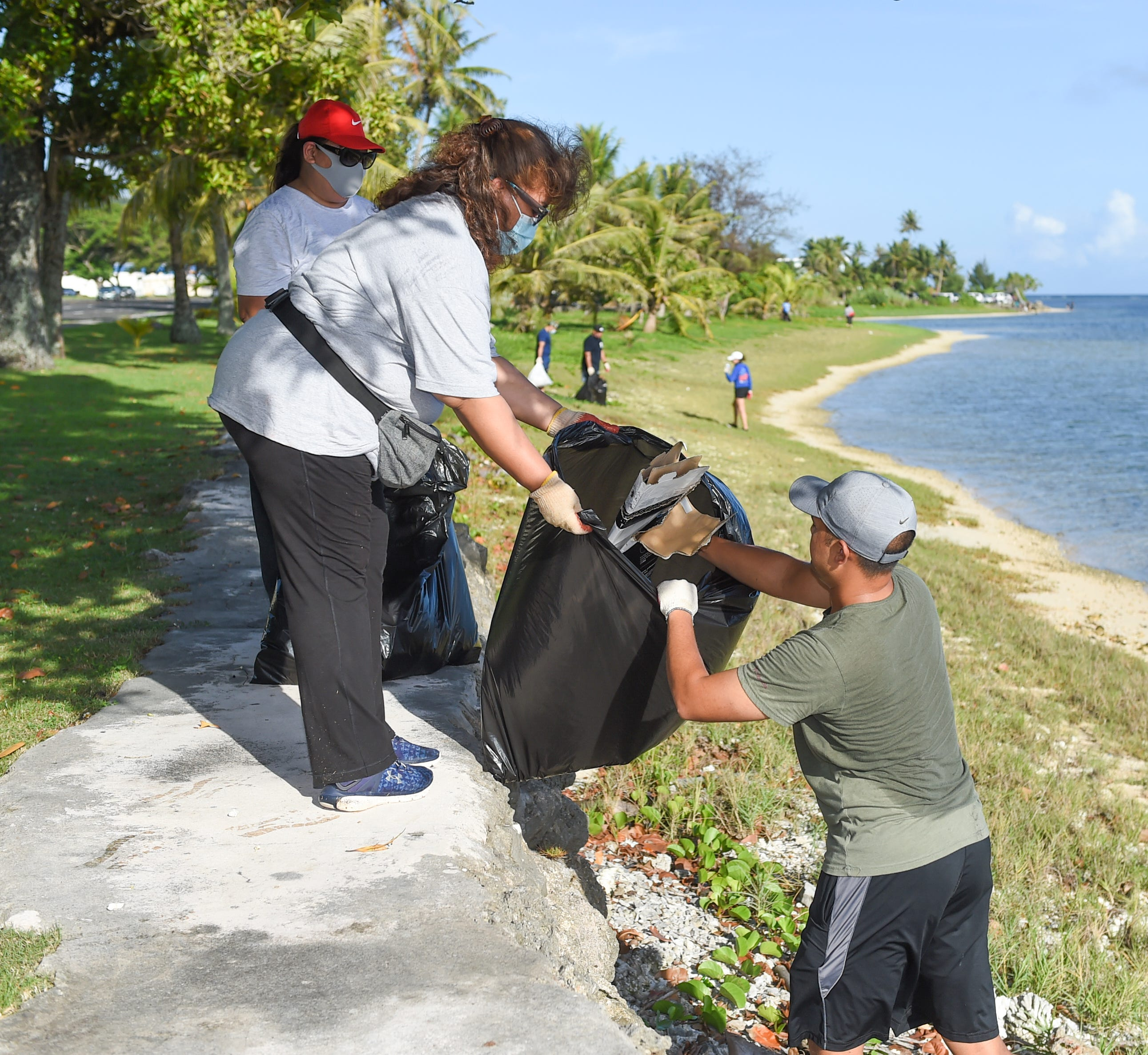 Volunteers from the Superior Court of Guam comb Hagåtña's beach side for rubbish during the #GUAM Island Pride Beautification Event on Aug. 1, 2020.